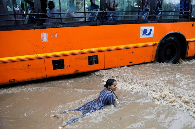 A girl plays on a flooded street after heavy rains in New Delhi, India, July 21, 2020. (Photo by /Reuters)