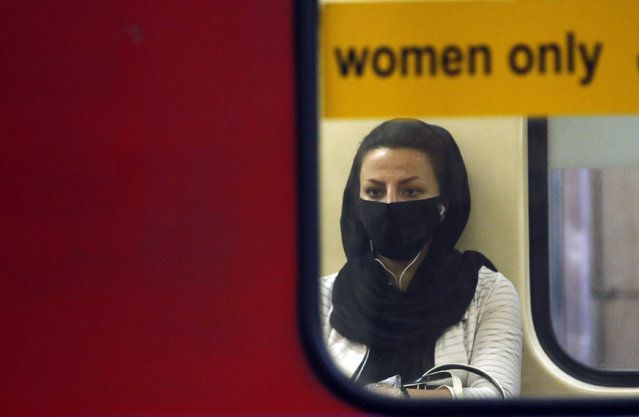 An Iranian woman wearing face mask sits in a train in a subway station in Tehran, Iran, 10 June 2020. Media reported that according to the last report by the health ministry the spread of novel coronavirus (Covid-19) is growing up while in past 24 hours 2011 new cases have been diagnosed and 84 people died. Iranian health ministry warned people to don?t use subways as much as they can. (Photo by Abedin Taherkenareh/EPA/EFE)