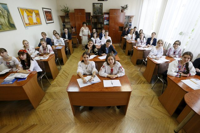 Art teacher Hanna Snitko poses for a picture with final year students, aged 16 to 17, of the Ukrainian Humanities Lyceum in their classroom in Kiev, Ukraine, September 24, 2015. (Photo by Gleb Garanich/Reuters)