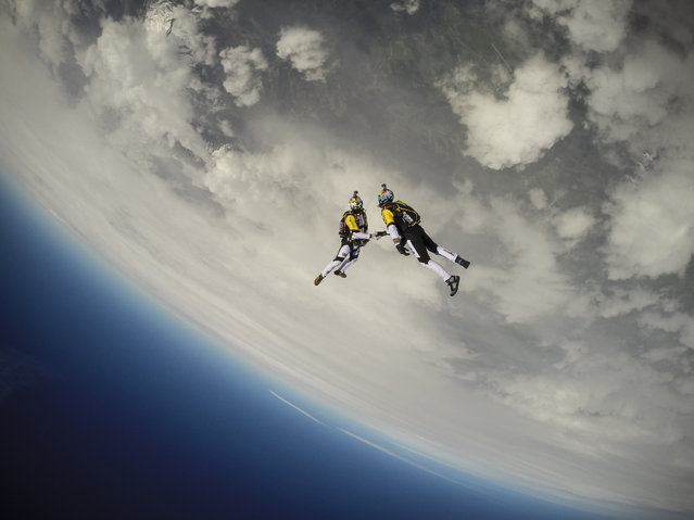 Soul Flyers Fred Fugen and Vincent Reffet perform during training in Austria for The Ultimate Skydiving Combo, skydiving from 33, 000 feet (10 km) above the Mont Blanc, in Austria. (Photo by Red Bull/SWNS.com)