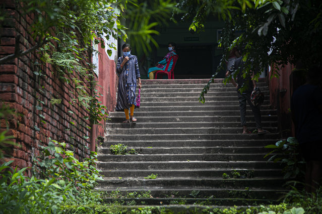 An Indian woman leaves after giving a nasal swab sample to test for COVID-19 in Gauhati, India, Friday, August 21, 2020. India has conducted 3 million tests for the virus, but experts have urged increasing its testing capacity greatly, since it has the world's second-highest population of 1.4 billion people. It has the third most cases in the world, behind the United States and Brazil, and the fourth highest number of deaths behind the U.S., Brazil and Mexico. (Photo by Anupam Nath/AP Photo)