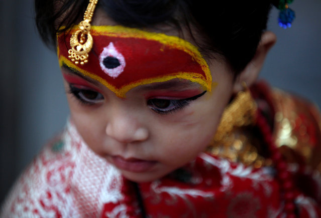 A young girl dressed as the Living Goddess Kumari takes part in the Kumari Puja festival in Kathmandu, Nepal September 14, 2016. (Photo by Navesh Chitrakar/Reuters)
