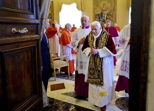 Pope Benedict XVI  leaves after attending a meeting of Vatican cardinals where he read a document in Latin in which he announced his resignation, February 11, 2012. The Pope announced that he would resign February 28 – the first pontiff to do so in nearly 600 years. (Photo by L'Osservatore Romano)