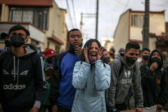 People protest outside a police station after a man, who was detained for violating social distancing rules, died from being repeatedly shocked with a stun gun by officers, according to authorities, in Bogota, Colombia on September 10, 2020. (Photo by Luisa Gonzalez/Reuters)