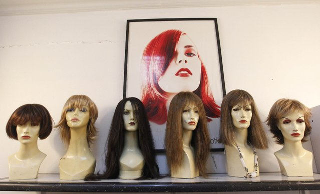 Natural hair wigs made by stylist Marcelo Avatte using donated hair, sit on mannequins waiting to be delivered to girls undergoing chemotherapy for cancer, at Avatte's salon in Vina del Mar, August 8, 2014. (Photo by Rodrigo Garrido/Reuters)