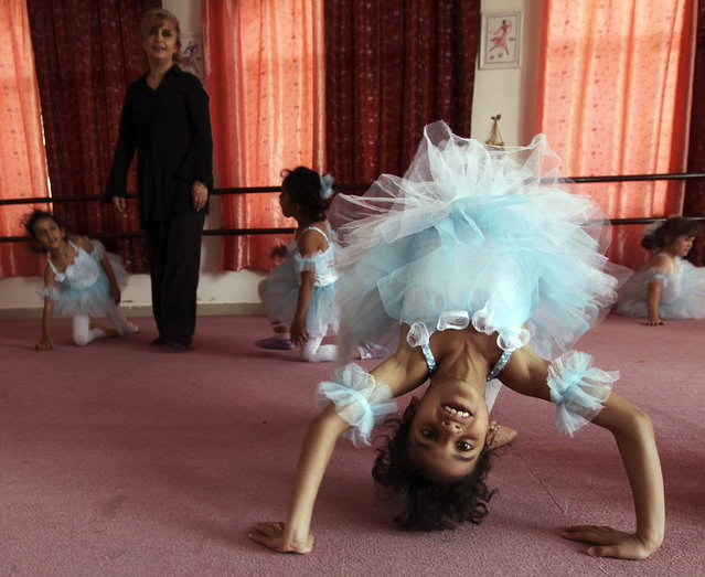 Girls attend their first ballet class at studio Cinderella in Sanaa March 12, 2013. (Photo by Mohamed al-Sayaghi/Reuters)