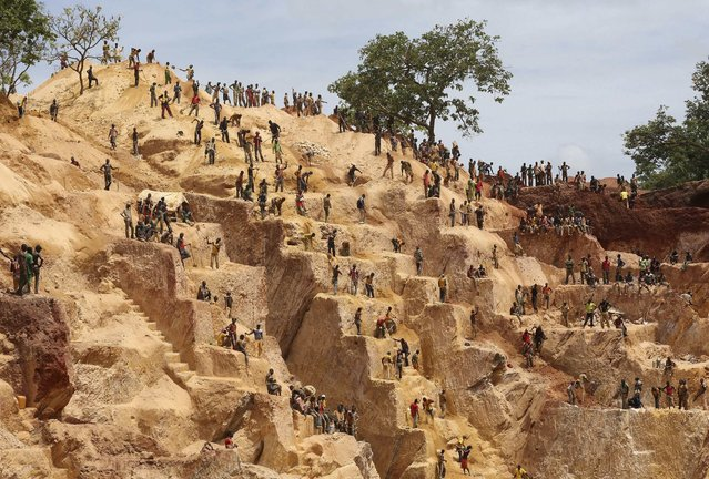 Prospectors work at the open-pit Djoubissi gold mine, north of Bambari, in this April 24, 2014 file photo. (Photo by Emmanuel Braun/Reuters)