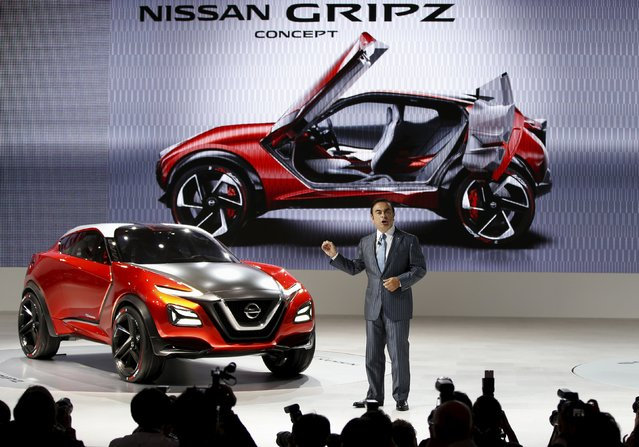 Carlos Ghosn, CEO of the Renault-Nissan Alliance speaks next to a Nissan Gripz concept car during a presentation at the 44th Tokyo Motor Show in Tokyo, Japan, October 28, 2015. (Photo by Toru Hanai/Reuters)