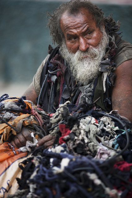 Homeless man Luis Irobo rests on the sidewalk in the Comas district of Lima, Peru, Thursday, September 29, 2016. Twenty-three percent of Peruvians are poor by IMF definition, as of 2015. (Photo by Rodrigo Abd/AP Photo)