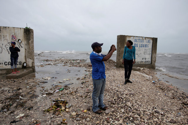 A man films the sea with his cell phone next to an old pier ahead of Hurricane Matthew in Les Cayes, Haiti, October 3, 2016. (Photo by Andres Martinez Casares/Reuters)