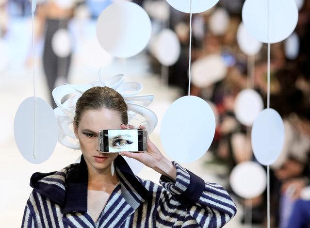 A model presents a creation by Ukrainian designer  Oleksiy Zalevskiy during Ukrainian Fashion Week in Kiev, Ukraine, October 12, 2016. (Photo by Gleb Garanich/Reuters)