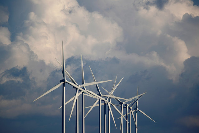 Power-generating wind turbines are seen at a wind park near Greneville-en-Beauce, France, November 30, 2017. (Photo by Christian Hartmann/Reuters)
