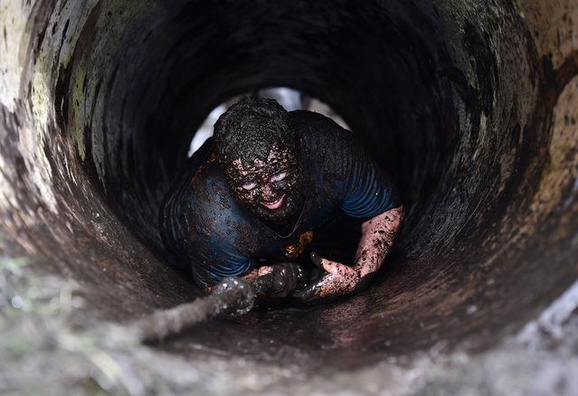 Competitors take part in the annual Mud Madness event at Foymore Lodge on April 22, 2018 in Portadown, Northern Ireland. The adult version of the event includes two laps of an 8km course through 25 obstacles while the kids event is run over 2kms. The race is in it's eleventh year and is sponsored by McVities Jaffa Cakes and event charity partner Marie Curie together with other numerous charities and fundraising groups. (Photo by Charles McQuillan/Getty Images)