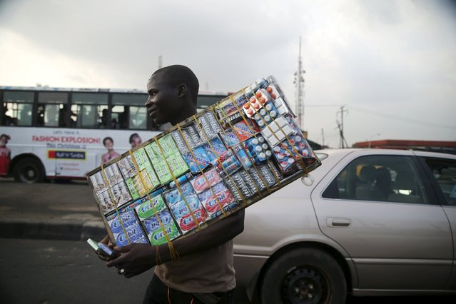 A man sells chewing gum along a road in Lagos, Nigeria, November 20, 2015. (Photo by Akintunde Akinleye/Reuters)