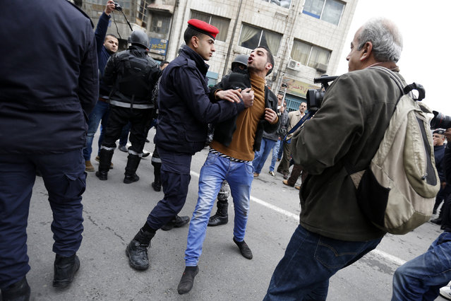 Jordanian security forces detain a demonstrator trying to reach the French embassy during a protest against satirical French weekly newspaper Charlie Hebdo, after the Friday prayer in Amman January 16, 2015. (Photo by Muhammad Hamed/Reuters)