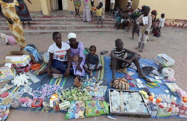 Children displaced as a result of Boko Haram attacks in the northeast region of Nigeria, sell sundry goods at a camp for internally displaced persons (IDP) in Yola, Adamawa State January 13, 2015. (Photo by Afolabi Sotunde/Reuters)