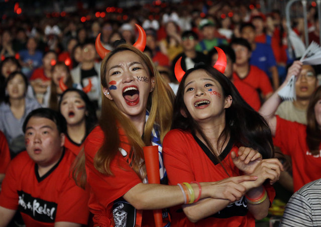 South Korean soccer fans celebrate as they watch a live broadcasting of the Group F World Cup soccer match between South Korea and Germany, at a public viewing venue in Seoul, South Korea, Thursday, June 28, 2018. (Photo by Ahn Young-joon/AP Photo)