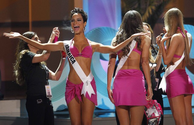 Miss Jamaica, Kaci Fennell, reacts to the crowd as her hair is sprayed during a commercial break at the 63rd Annual Miss Universe Pageant in Miami, Florida, January 25, 2015. (Photo by Andrew Innerarity/Reuters)
