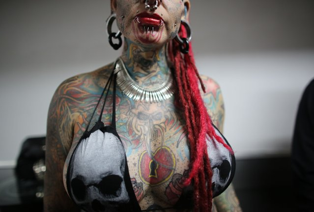 Mary Jose Cristerna, a Mexican known as The Vampire Woman, poses for the public to take portraits of her during the annual Venezuela Tattoo International Expo in Caracas, Venezuela, Thursday, January 29, 2015. (Photo by Ariana Cubillos/AP Photo)