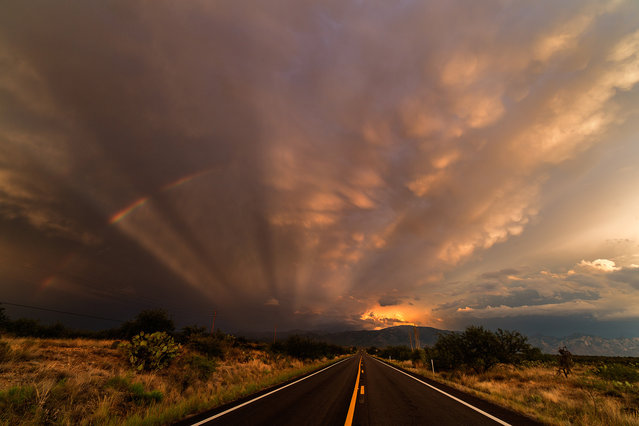 A gorgeous Arizona sunset north of Tucson - the sky is covered with mammatus clouds, anti-crepuscular rays and rainbow on July 29, 2015 in Arizona, United States. (Photo by Mike Olbinski/Barcroft Media)