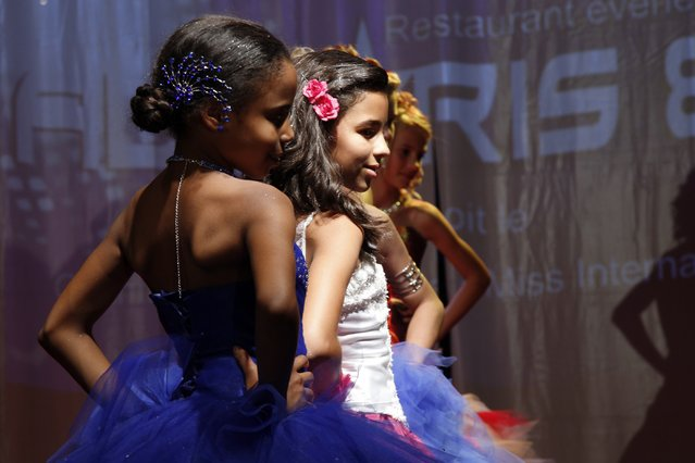 "Contestants walk on stage during the ""mini-miss"" beauty contest in Bobigny, Paris suburb, September 22, 2012. The competition is open for girls aged 7 to 12. (Photo by Benoit Tessier/Reuters)"