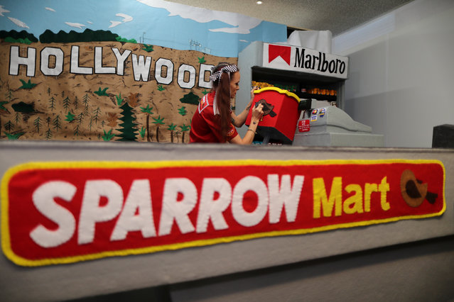 British artist Lucy Sparrow, puts finishing touches on her art installation supermarket in which everything is made of felt, in Los Angeles, California on July 31, 2018. (Photo by Lucy Nicholson/Reuters)