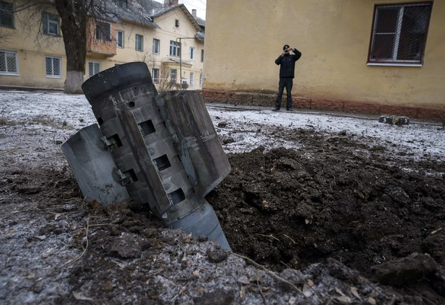 The remains of a rocket shell is seen on a street in the town of Kramatorsk, eastern Ukraine February 10, 2015. (Photo by Gleb Garanich/Reuters)