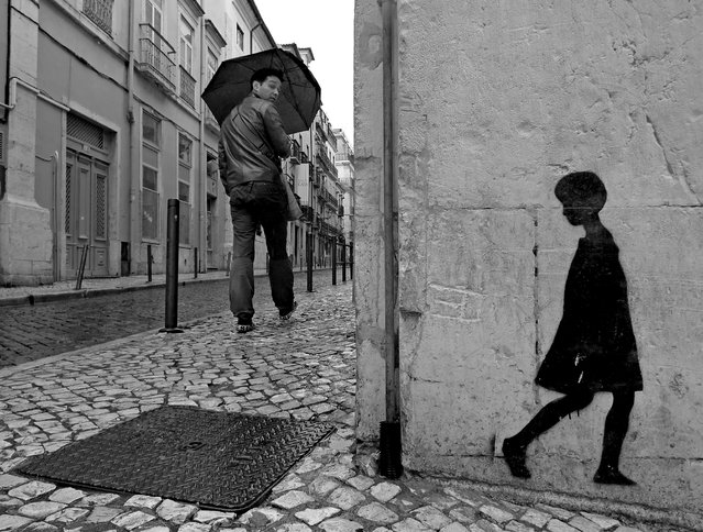"""Behind You. Lisbon, Portugal, 2011"". (Photo by Tom)"
