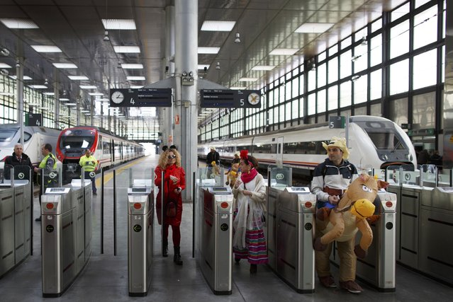 Revellers arrive at a train station to participate in the Carnival of Cadiz, southern Spain February 15, 2015. (Photo by Marcelo del Pozo/Reuters)