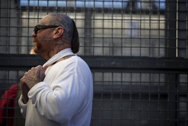 Robert Galvan, who is on death row for murder, speaks to members of the media at the Adjustment Center yard during a media tour of California's Death Row at San Quentin State Prison in San Quentin, California December 29, 2015. America's most populous state, which has not carried out an execution in a decade, begins 2016 at a pivotal juncture, as legal developments hasten the march toward resuming executions, while opponents seek to end the death penalty at the ballot box. (Photo by Stephen Lam/Reuters)