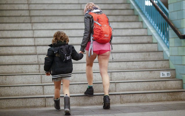 A mother and her son take part in the 'No Pants Subway Ride' in Berlin, January 10, 2016. The 'No Pants Subway Ride' is an annual event that has become a global celebration of bare thighs. The 'celebration of silliness' is designed to make other Tube riders smile. (Photo by Hannibal Hanschke/Reuters)