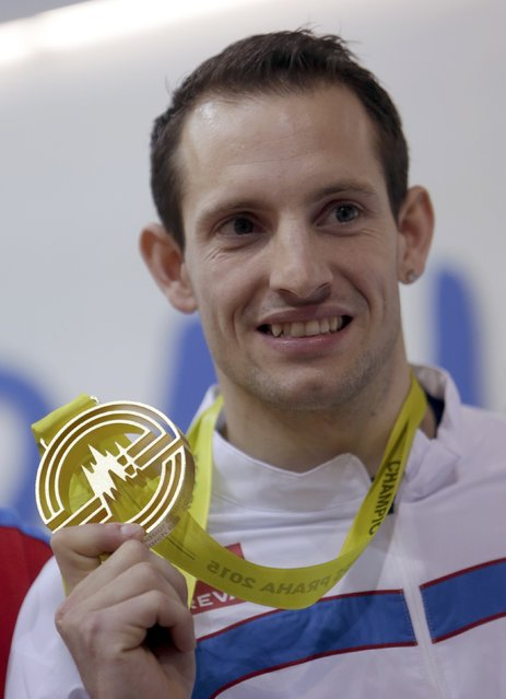 Winner Renaud Lavillenie celebrates on the podium at the medal ceremony for the men's pole vault final during the European Indoor Championships in Prague March 8, 2015. REUTERS/David W Cerny (CZECH REPUBLIC  - Tags: SPORT ATHLETICS)