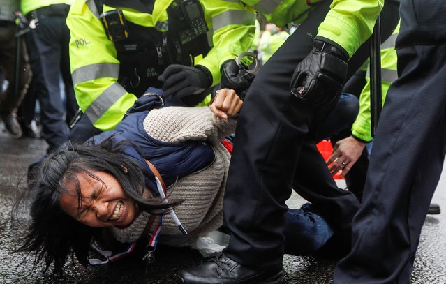 An anti-vaccine demonstrator is detained by police officers during a protest in Westminster, amid the coronavirus disease (COVID-19) pandemic, London, Britain, June 21, 2021. (Photo by Peter Nicholls/Reuters)