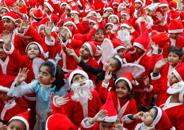 Children dressed in Santa costumes participate in Christmas celebrations at a school in Chandigarh, India, December 24, 2016. (Photo by Ajay Verma/Reuters)