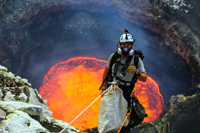 Here are the bravest of the brave in 2016. Weve gathered some of the finest images showing daredevils taking their lives into their own hands and going to the very brink this year. Whether they are perched hundreds of feet up on a high wire, courageously clinging to a rockface or taking on a volcano, these adventurers take the breath away. Here: Nik Halik absailing down into Marum an active lava lake of Ambrym, Vanuatu. (Photo by Chris Horsley/Caters News)