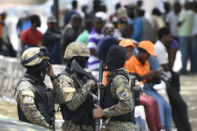 Security forces stand outside the National Pantheon Museum during a memorial ceremony for the late Haitian President Jovenel Moise in Port-au-Prince, Haiti, Tuesday, July 20, 2021. (Photo by Matias Delacroix/AP Photo)