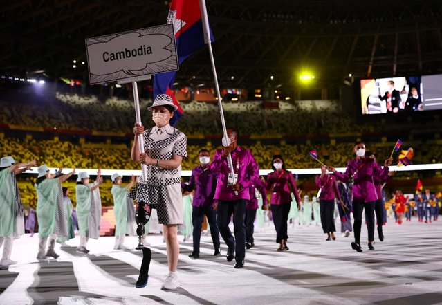 Flag bearers Bunpichmorakat Kheun and Sokong Pen of Team Cambodia during the Opening Ceremony of the Tokyo 2020 Olympic Games at Olympic Stadium on July 23, 2021 in Tokyo, Japan. (Photo by Kai Pfaffenbach/Reuters)