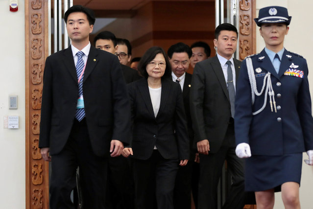 Taiwanese President Tsai Ing-wen (C) departs for her visit to allied nations in Latin America at Taoyuan International Airport, Taiwan January 7, 2017. (Photo by Tyrone Siu/Reuters)