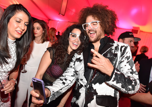 Redfoo poses with guests at the Candy Crush Jelly Saga – Primary Wave Pre-Grammy Party at The London Hotel on Sunday, February 14, 2016, in Los Angeles. (Photo by Jordan Strauss/Invision for Ketchum (New York)/AP Images)