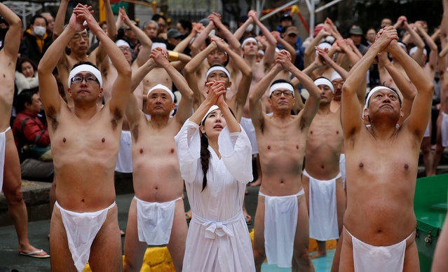 People wearing loin cloths pray after they bathe in ice-cold water outside the Teppozu Inari shrine in Tokyo, Japan, January 8, 2017. (Photo by Toru Hanai/Reuters)