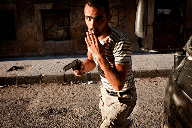 """A """"Free Syrian Army"""" fighter in the Bustan Pasha neighborhood of Aleppo, Syria, August 21, 2013. (Photo by James Lawler Duggan)"""