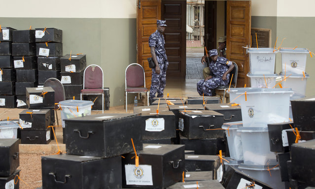 Ugandan police guard electoral boxes at a district counting center in Kampala, Uganda Saturday, February 20, 2016. (Photo by Ben Curtis/AP Photo)
