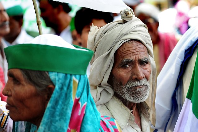 An Indian farmer of the Bharatiya Kisan Union (BKU) – Indian Farmers' Union – listens to a speech by the leadership during a protest demanding compensation for damage to crops due to fluctuating rains and the waiving of electricity bills and loan interest, in Allahabad on April 7, 2015. (Photo by Sanjay Kanojia/AFP Photo)
