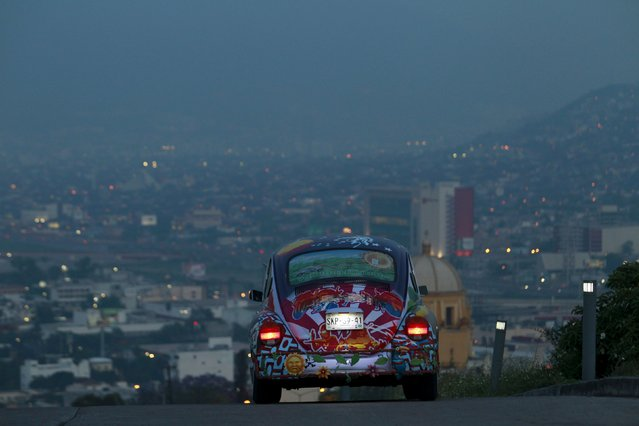 """Rene Penia drives his VW Beetle 1995, locally called """"Vocho"""", through the streets of Monterrey, Mexico in this April 22, 2015 file photo. VW is expected to report Q4 results this week. (Photo by Daniel Becerril/Reuters)"""