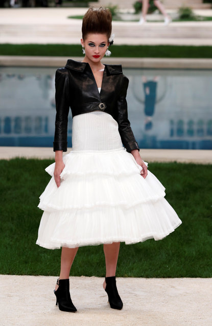 """A model presents a creation by German designer Karl Lagerfeld as part of his Haute Couture Spring-Summer 2019 collection show for fashion house Chanel at the Grand Palais transformed into the """"Villa Chanel"""" in Paris, France, January 22, 2019. (Photo by Benoit Tessier/Reuters)"""