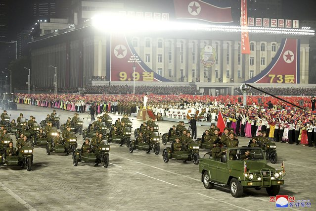 In this photo provided by the North Korean government, North Korean solders on vehicles parade during a celebration of the nation's 73rd anniversary that was overseen by leader Kim Jong Un, at Kim Il Sung Square in Pyongyang, North Korea, early Thursday, September 9, 2021. (Photo by KCNA via KNS/AFP Photo/Stringer)