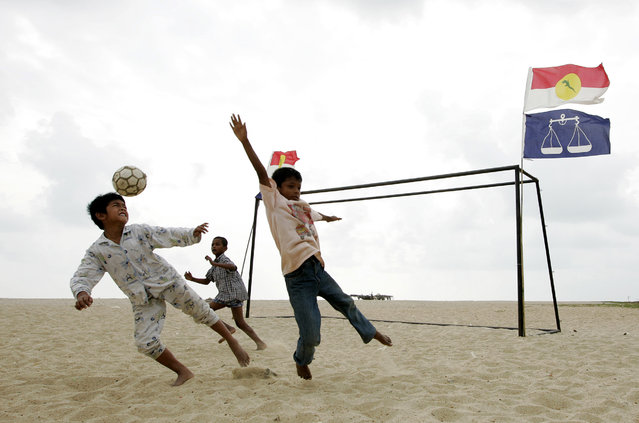 Children play soccer at a beach in the east coast state of Terengganu, Malaysia, February 15, 2008. (Photo by Zainal Abd Halim/Reuters)