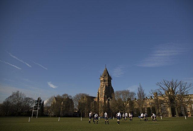 Pupils take part in rugby practice on the playing fields of Rugby School in central England, January 20, 2015. (Photo by Neil Hall/Reuters)