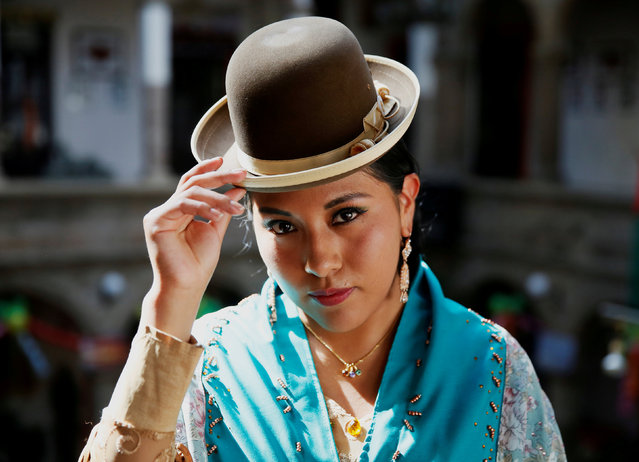 A Cholita (Andean woman) model poses during a practice session of Rosario Aguilar fashion model school in La Paz, Bolivia, February 23, 2019. (Photo by David Mercado/Reuters)