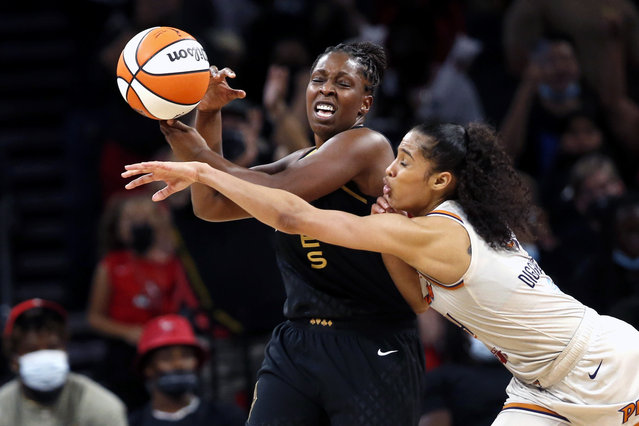 Las Vegas Aces guard Chelsea Gray (12) is fouled by Phoenix Mercury guard Skylar Diggins-Smith (4) during the second half of Game 1 in the semifinals of the WNBA playoffs Tuesday, September 28, 2021, in Las Vegas. The Aces beat the Mercury 96-90. (Photo by Steve Marcus/AP Photo)